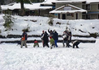 Students playing with snow